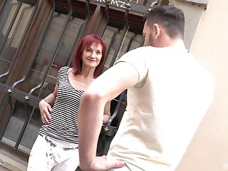 Mature redhead Irena picks up a guy off the street for a hard fuck