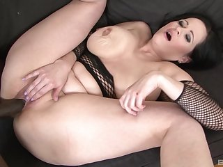 Mature brunette in fishnets Diana Swiet pounded by a black dick