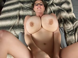 Mommy in glasses shows off her huge breasts