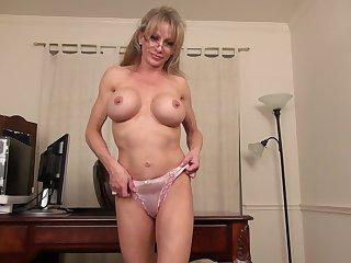 Busty blonde MILF secretary Jill E. strips at the office