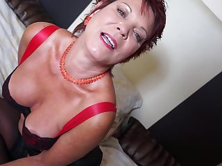 Short haired playful mature amateur Sexy Scorpion plays with a dildo