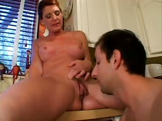 Older woman and her neighbor end up having some hot kitchen sex