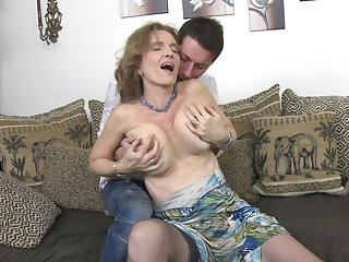 Mature blonde with saggy tits Raina W. gets fucked doggy style
