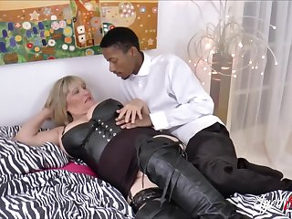 Busty blonde mature gets big black cock deep inside her vagina