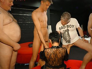 Aged experienced prostitute is fucked hard by several kinky dudes