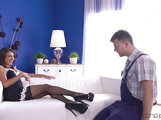 A hot Mistress in a French maid outfit has fun with her slave.
