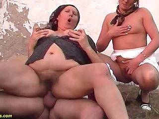 Rough threesome anal orgy at the family farm