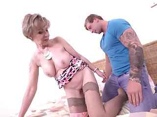 Tattooed amateur dude bangs mature granny Maris on the bed