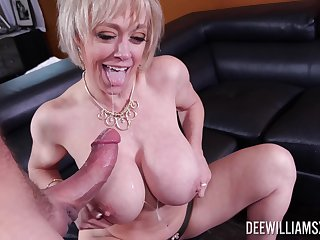 Pornstar Dee Williams teases with her massive jugs and gets fucked
