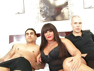 Threesome with two amateur guys and one mature slut with big tits