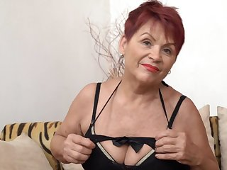 Czech Granny GILF with big saggy tits and shaved pussy poses solo