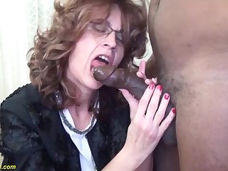 Curly hair mature with glasses enjoys a wild interracial ride from her black BF