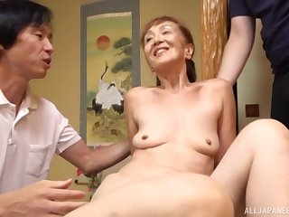 Japanse mature Asano Taeko spreads her legs to be fucked by two guys
