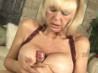 Mature woman Shelly loves to use her enormous boobs to give a titjob