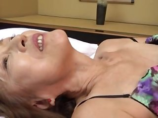 Mature Japanese Asano TAeko spreads her legs and drills her holes