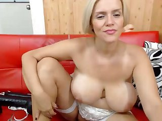 Chubby blonde mommy with big tits plays toys