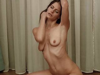 Skinny mature with saggy tits in solo posing