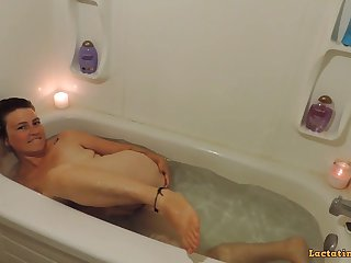 HQ Milkymama submerged in tub then plays with clit