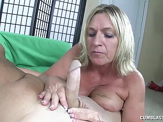 Mature mommy takes a big dick in her hands and mouth - Brandi James