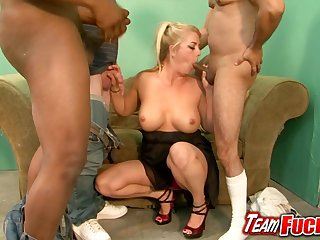 Bushy mature blonde gives blowjobs to three chubby nerds