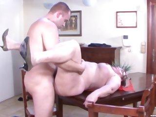 Mature amateur Rose B. drops on her knees to make him hard