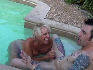 Mature slut Leilani Lei fucked by a younger stud by the pool