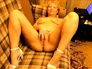 Sexy Russian mature mom masturbate on sofa
