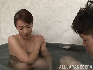 Skinny darling Hisae Yabe enjoys pleasuring a shy younger man