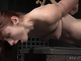 Extreme bondage for this mature redhead