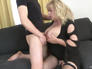 Mature slut plays with her large tits and gets ass fucked good
