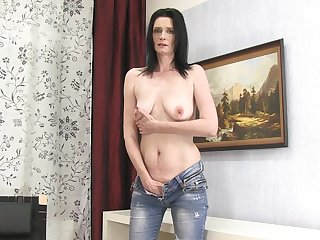 Dirty mature amateur Laura Dark takes off her jeans to masturbate