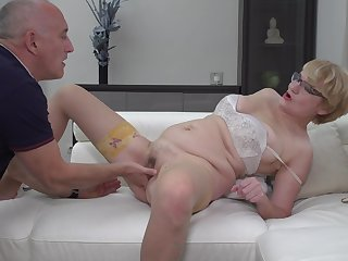 Nerdy mature blonde amateur Rina M. blows and rides her husband