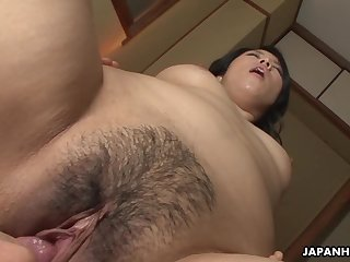 Mature brunette Asian gets her hairy cunt filled up