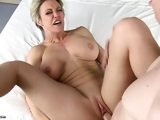 Rion King fucks short haired MILF in various positions