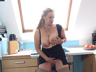 Beate A. licks her glass dildo before pussy insertion