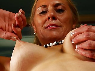 Amateur mature blonde Cristine Ruby licks her tits and feet