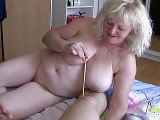 Two mature ladies are trying really hard to please this stick