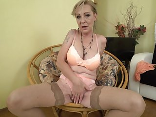 Mature blonde granny Maris pounds her pussy in stockings