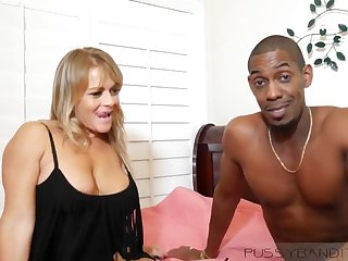 Busty blonde MILF enjoys muscled black stud with BBC