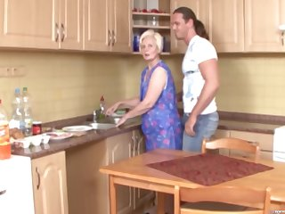 sexy granny Kaitlin spreads her legs for a friend's penis in the kitchen