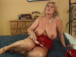 Blonde mature Gitte moves her dress for a long and strong penis