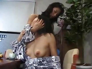 2 Mature Women Sucking Nipples Kissing Patting At The Desk In The Dining Roo
