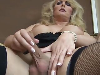 Mature blonde shemale solo masturbation in black lingerie