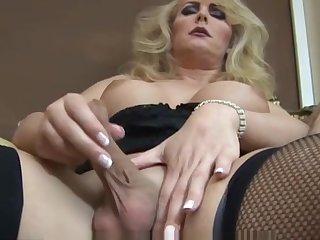 Mature blonde shemale solo masturbation in black lingerie