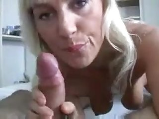 Horny GILF with sweet sensual lips teases cock of youngster