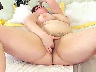 BBW milf Jayne Storm fingers her hairy pussy
