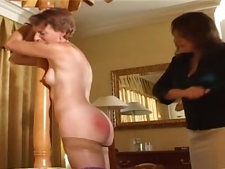 Older woman spanked by lady of the house